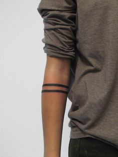 Lines arm bands tattoo