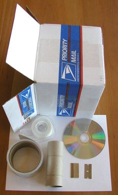 """Light and Optics - How to make a spectroscope using a cd, paper tube, aluminum tape, 2 razor blade and a cardboard box:  A spectroscope separates light waves!  """"A spectroscope is a device that lets us find out what things are made of. It works by taking light and splitting it up into its component colors."""""""