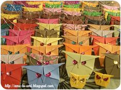 Owls designed by Shoko Aoyagi. An army and two yellow little fellows ;-). http://ame-to-umi.blogspot.com/2012/10/japonskie-sowy-z-papieru-ovo.html