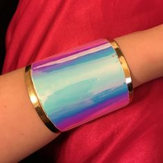 Holographic Joyce Leslie mermaid cuffling This was my favorite the changing colors make it fit so many outfits Joyce Leslie Jewelry Bracelets