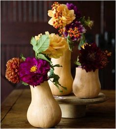 White gourds make elegant and simple vases.  Place a small arrangement at each table place setting or combine a group for a great centerpiece.