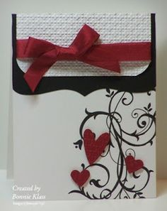 I love this handmade valentine's card with swirls and hearts and a pretty burgandy ribbon and bow