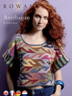 Aserbajdsjan. Imponerende flot bluse. Det er en typisk Kaffe Fassett-modil, strikket i intarsia. Der er brugt 14 forskellige farver. Pinde 5.