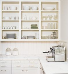 carrera marble countertop with painted paneled backsplash by Gast Architects, Remodelista.like the open cabinets Open Kitchen Cabinets, Painting Kitchen Cabinets, Kitchen Paint, Kitchen Shelves, White Cabinets, Tall Cabinets, Gloss Kitchen, Glass Cabinets, Organized Kitchen
