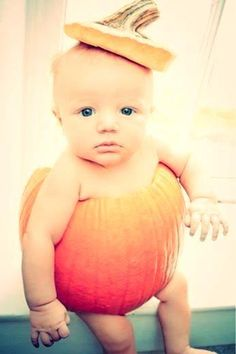 Baby in a pumpkin with a hat