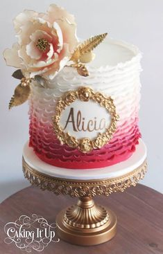 Pretty Pink Ombre Ruffled Cake with Gold Accents and Beautiful Sugar Flower