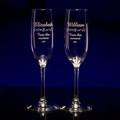 wedding toast flutes for the bride and groom.  custom engraved with their names, dates and any message!  from GlassWithATwist.com