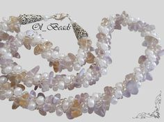 Light-colored amethyst chips are weaving together with milky white beads creating a romantic tune. A charming choice for any occasion.  Total length is 51cm.