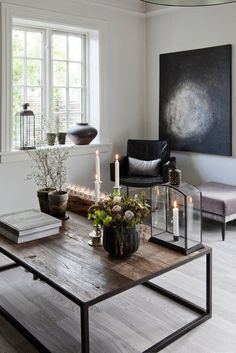 LOVE the atmospheric quality of this room. I would put a bold colorful rug for my liking~