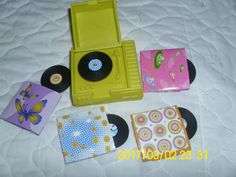 DOLL ACCESSORIES RECORD PLAYER YELLOW PLASTIC  FOUR RECORDS WITH COVERS  RARE!  #Mattel