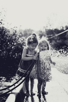 The Hose. Children. Summer. Water. Happy. Playful. Experience. Wonderful. Friendship. Family. Life. Love. Great Photo. Excitement. Black & White.