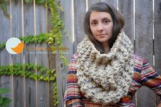 This oversized tall chunky cowl is the perfect accessory to keep her or him warm this fall and winter! It is knitted with multiple strands of