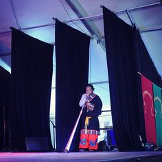 Playing the Dongchen (ritual horn) for the beginning of our Tibetan dances at the biggest festival in the Southern Hemisphere. Circular breathing is necessary to play this horn for lengthy amounts of time which I learnt while a monk in Chokling monastery.