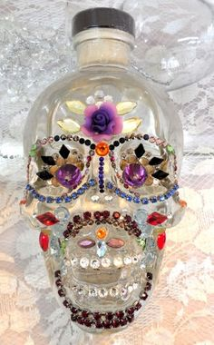 SOLD----Crystal Head Vodka bottle decorated sugar skull w Swarovski crystals. More to choose from in our Artfire Store Skull Vodka Bottle, Glass Bottles, Perfume Bottles, Crystal Head Vodka, Skull Crafts, Crystal Skull, Bottle Art, Sugar Skull, Swarovski Crystals