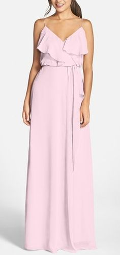 Pretty pastel bridesmaid dress by nouvelle AMSALE. Comes in 7 colors including this pink peony. Soft and romantic, this blush-hued gown in silky chiffon flows gently from the spaghetti straps to a floor-grazing hem. The ruffled-overlay surplice bodice and wrap-style skirt flatter the figure, while a coordinating tie belt defines feminine curves.