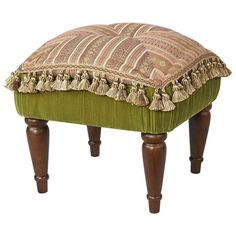 Showcasing tassel accents and striped upholstery, this wood-framed ottoman makes the perfect addition to your living room or master suite.  ...
