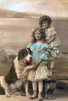 Sweet vintage photo of girls with their big dog.