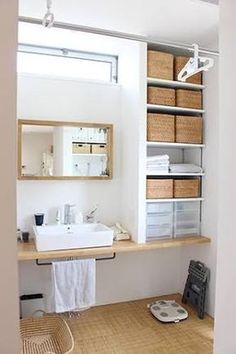 Bathroom storage. The curtain rod can be used for drying laundry. Open shelves beside the sink and under it.