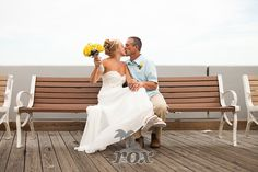 Kiss On The Boardwalk Bench After A Beach Wedding In Ocean City Maryland By Rox