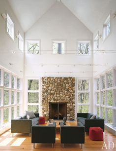 Symmetry rules in this white-walled, double-height living room.