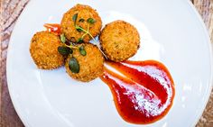 Quinoa croquettes with rocoto chile + strawberry jam.  Photograph: Paul Winch-Furness.
