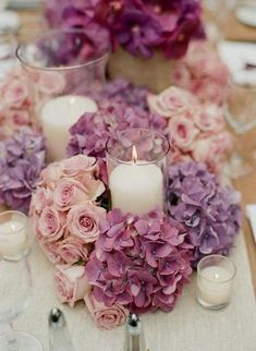 Luscious roses and hydrangea candle centrepieces #weddings #Brighton