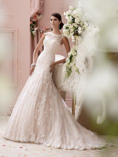 2015 Wedding Dress Collection– Sleeveless hand-beaded corded lace appliqué, tulle and organza over satin slim A-line wedding dress features a jeweled illusion bateau neckline edged with beaded corded lace, softly curved hand-beaded corded lace appliquéd bodice with dropped waist, illusion and beaded lace plunging deep V-back bodice, softly gathered tulle and organza skirt with matching [...]