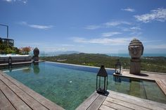 Villa Belle, Ko Samui, Thailand,beautiful, luxurious, stunning, hillside, location, tropical, gardens, platform, house, open plan, living space, wooden terrace, swimming pool, outdoor, seating, villa, antique, contemporary,