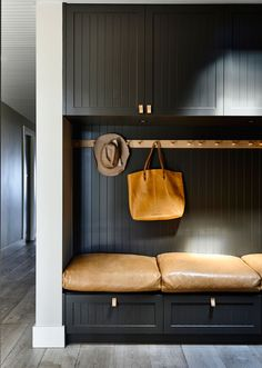 Black board & batten + leather cushions. Good idea for a wide hallway space, good place to tie your laces :)