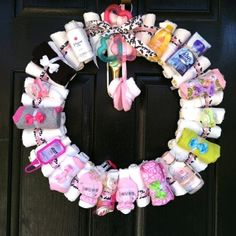 Socks, wash cloths and burp rags, hand sanitizer for the 'baby shower' diy wreath! Love this cute idea.