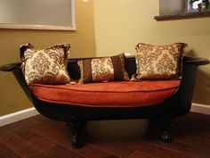 What was once a bathtub is now a loveseat — and one of the furnishings in Rachel's craft room. A diamond grinder was used to create the cut-out in the cast-iron tub, which was then re-glazed in black and outfitted with a custom sofa cushion. From DIYnetwork.com