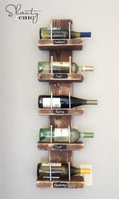 You can actually make your own wine rack for under $15. This is a great idea for those who just need to store a few bottles and wine bottles are so decorative that you can hang them in the kitchen or dining room and give the room décor a little lift. If you want, you can label the shelves or just leave them blank so you can add whatever wine you want. Via: Shanty 2 Chic - DIY Wine Rack