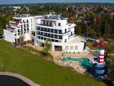 Vital Hotel Nautis Vital Hotel Nautis is situated in Gárdony on the shore of Lake Velence. It offers a spa area with an outdoor and indoor pool and air-conditioned rooms with free WiFi. Vital Hotel, Free Wifi, Lodges, Modern Furniture, Spa, Indoor, Mansions, House Styles, City