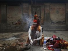 A Hindu holy man rubs ashes into his hands at the Pashupatinath temple, where holy men from Nepal and India gather for the Shivaratri festival, marked by praying and the smearing of ash on their bodies. Photograph: Navesh Chitrakar/Reuters