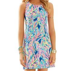 """Lilly Pulitzer Palm Reader Cathy Dress This is a beautiful shift dress that just screams Florida sunshine! Featured in Indigo Palm Reader--it's the ideal style for tea at The Breakers or lunch on Worth Avenue. Retired print. Zipper at back with signature palm tree zipper and white embellishment. Lightly lined. Cotton. Bust {36"""".} Lilly Pulitzer Dresses"""