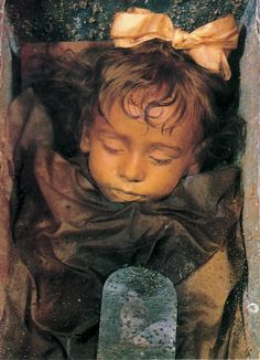 Rosalia Lombardo was two years old when she died December 6th 1920 due to pneumonia. She was embalmed by Alfredo Salafia. The process he used was a secret originally believed he took to his grave. Dario Piombino-Mascali, biological anthropologist, has claimed to have discovered it in 2010. Her body rests in a glass coffin in the Capuchin Catacombs in Palermo, Sicily.
