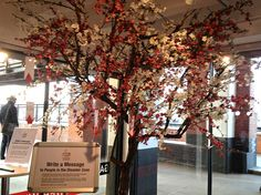 Great East Japan Press Photo Exhibition - foyer by sequins and cherry blossom, via Flickr