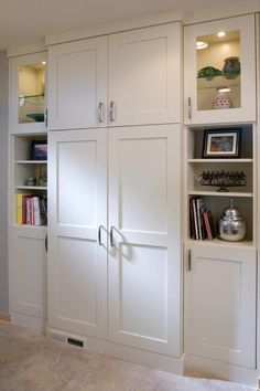 White Dura Supreme Cabinetry in a transitional kitchen design with large pantry designed by Ispiri.