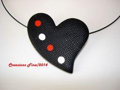 Corazón negro con lunares
