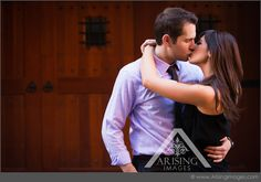 Cute engagement photo in downtown Birmingham. #arisingimages #engaged #couple #photoshoot #love #kiss #engagement