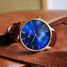 Navona Blue/G with 41 mm polished gold case, small seconds, brushed navy blue dial and brown italian leather strap. Free shipping worldwide - www.bonvier.com #bonvier #watches #orologi