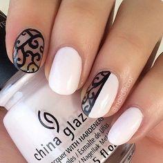 Black And White Negative Space Nail Design.