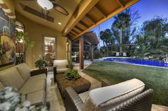 Gorgeous covered patio that opens up to the lush landscaping and tile pool.  Scottsdale Arizona