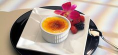 Crème Brulee- Baked custard, under a crunchy caramelized topping, seasonal flavors