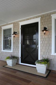wide door.  Beige shingles and black door.