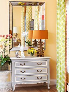 A fabulous mix of fun and colorful accessories. Check out more photos of this space: http://www.bhg.com/rooms/living-room/makeovers/orange-living-room/#page=3