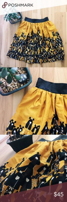 """HP Anthropologie Yellow Printed Skirt Mustard-yellow skirt with pockets (!!!) and black waistband -- elastic on the back, smooth in the front. Modern Geisha print. Lined. 100% cotton shell and lining. (""""edme & esyllte"""", sold by Anthro.) Approximately 12.5"""" across waist, laid flat, 21"""" long. Anthropologie Skirts A-Line or Full"""