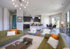 """Mid-century modern couches face each other with a """"sputnik"""" chandelier overhead. Mid Century Modern Couch, Palm Springs Vacation Rentals, Sputnik Chandelier, Mid Century Style, Terrazzo, Mid-century Modern, Flooring, Bed, Table"""