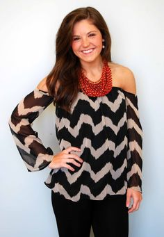 We love this off the shoulder top! The top is lined, and the arms are sheer. YES!
