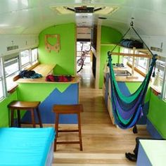 I love the open layout, colors, and the hanging chair idea. A great use of space!